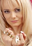 Aggressive golden jewelry girl Royalty Free Stock Photography