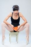 Aggressive gymnast sitting on a chair with cup Royalty Free Stock Image