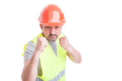 Aggressive handsome constructor acting violent and fighting. With someone isolated on white with advertising area stock images