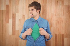 Aggressive hipster opening shirt in superhero style Stock Photo