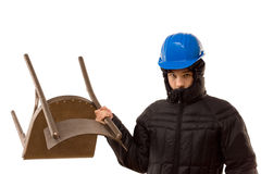 Aggressive hooligan wielding a wooden chair Royalty Free Stock Photo