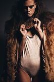 Aggressive hot woman in fur coat Royalty Free Stock Photo