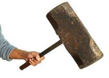 Aggressive human hand holding big hammer Royalty Free Stock Photo