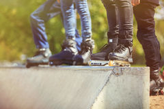 Aggressive inline rollerblader standing on ramp in skatepark Royalty Free Stock Photography