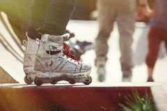 Aggressive inline rollerblader standing on ramp in skatepark Royalty Free Stock Images