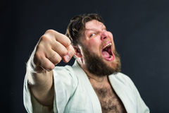 Aggressive karateka Stock Photography