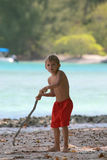 Aggressive kid. With a wood pole Royalty Free Stock Photo