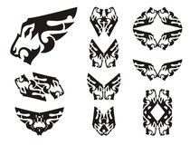 Aggressive lion head symbols in the form of a wing. Tribal peaked lion head set, great for vehicle graphics, tattoos, stickers and T-shirt designs. Ready for Royalty Free Stock Image