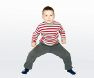 Aggressive little boy on a combined background Royalty Free Stock Images