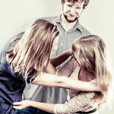 Aggressive mad women fighting over man. Jealous girls wooing guy. Violence Stock Photos