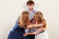 Aggressive mad women fighting over man. Young jealous girls wooing guy. Violence Royalty Free Stock Photography
