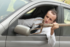 Aggressive male driver in his car Royalty Free Stock Photo