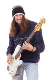 Aggressive male musician playing bass guitar Royalty Free Stock Photo