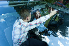 Aggressive male passenger in car Stock Image