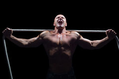 Aggressive man with arms outstretched holding rope Royalty Free Stock Image