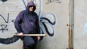 Aggressive man with a baseball bat stock footage