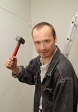 Aggressive man with a big hammer. Angry, aggressive man with a big hammer Stock Photos