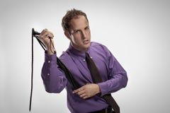 Aggressive man with a black lash Royalty Free Stock Photos