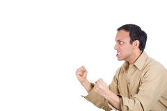 An aggressive man clenching his teeth and fist Royalty Free Stock Images