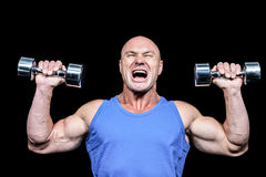 Aggressive man lifting dumbbells Stock Image