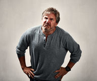 Aggressive man. Aggressive mad man portrait over gray background Royalty Free Stock Images