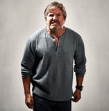Aggressive man. Aggressive mad man portrait over gray background Stock Image
