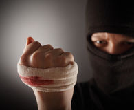 Aggressive man in the mask Stock Photography