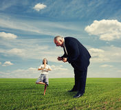 Aggressive man and meditation woman Royalty Free Stock Photo