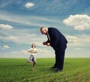 Aggressive man and meditation woman Royalty Free Stock Photo