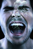 Aggressive Man Shouting Underwater. Closeup of aggressive young man shouting underwater Royalty Free Stock Images