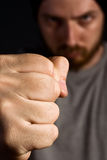 Aggressive man showing his fist Stock Photo