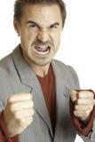 Aggressive man wants to hit somebody. Closeup of an aggressive man which wants to hit somebody Royalty Free Stock Photos