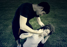 Aggressive man with woman Stock Photography
