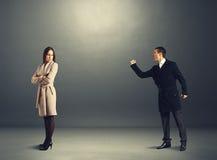 Aggressive man yelling at the woman Stock Image