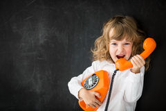Aggressive management. Aggressive kid calling by vintage phone Royalty Free Stock Image