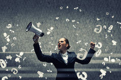 Aggressive management. Young upset businesswoman screaming furiously in megaphone Royalty Free Stock Images