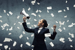 Aggressive management. Young upset businesswoman screaming furiously in megaphone Stock Images