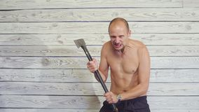 Aggressive maniac killer with an ax indoors.  stock video