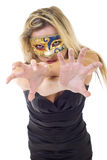 Aggressive masked woman. Aggressive woman wearing a venetian mask over white - focus on hands stock photo