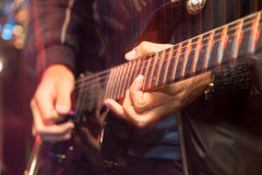 Aggressive play guitar on stage. A photo Stock Photo