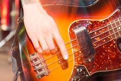 Aggressive play guitar on stage. A photo Stock Images