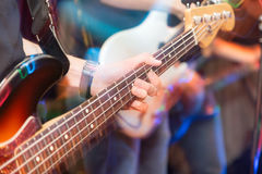 Aggressive play guitar on stage. A photo Stock Image