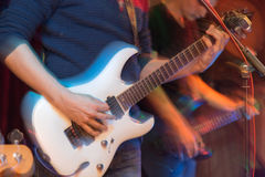 Aggressive play guitar on stage. A photo Stock Photos