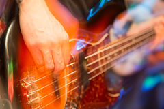 Aggressive play guitar on stage. A photo Royalty Free Stock Photos