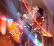 Aggressive play guitar on stage. A photo Royalty Free Stock Images