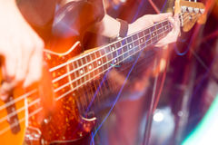 Aggressive play guitar on stage. A photo Royalty Free Stock Photo