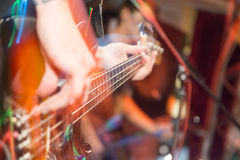 Aggressive play guitar on stage. A photo Royalty Free Stock Photography