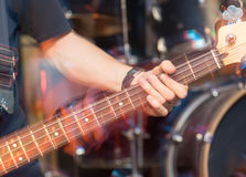 Aggressive play guitar on stage. A photo Royalty Free Stock Image