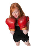 Aggressive redhead woman boxer Stock Image