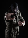 Aggressive robbery. Man pointing gun at people in a robbery scene Royalty Free Stock Photos